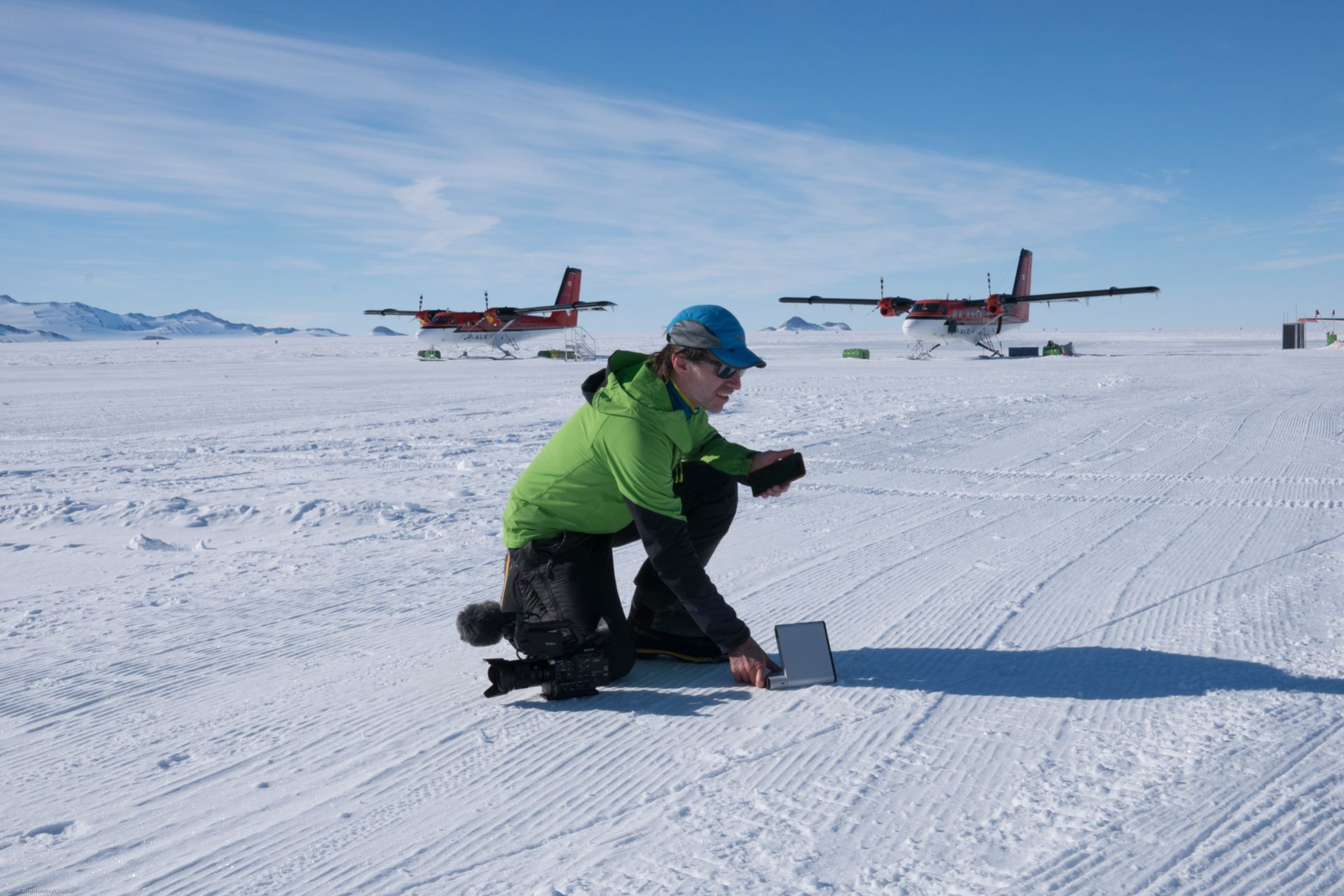 Dave Carter transmitting images from Antarctica with Ranulph Fiennes